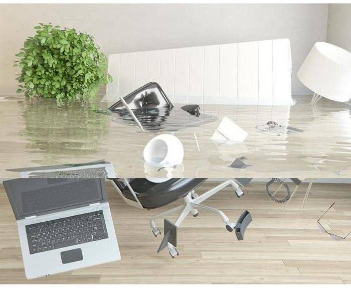Office items floating in flooded office